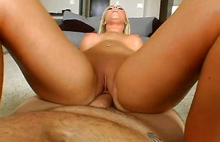Alluring busty mature blonde honey Ahryan Astyn's perky tits bounce as she rides a meat bazooka