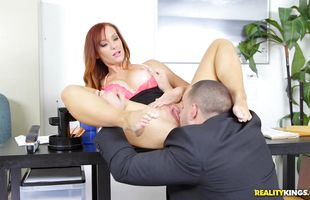 Spicy mature redhead floozy Dani Jensen with impressive tits is drooling over hunk's rock hard phallus because she likes it a lot