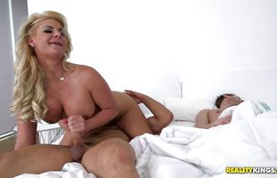 Vigorous mature Phoenix Marie endures a severe and rough pounding from behind