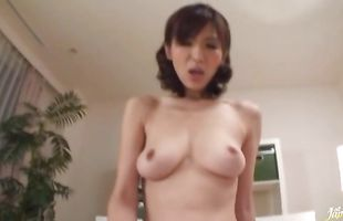 Alluring floosy gives an blowjob to a hard pecker