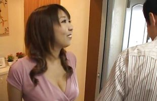 Voluptuous Yuuko Sakurai is swallowing his dick whole and loving it