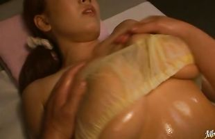 Fascinating busty mature Hitomi Tanaka sits her perfect tang on buddy's boner