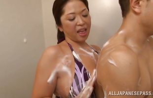 Playful mature beauty Natsuko Kayama reveals her perfect tits to a pussy tester
