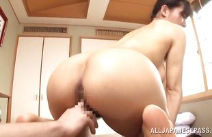 Stunning busty mature Yukino Shindou slams her needy love tunnel on a large packing monster