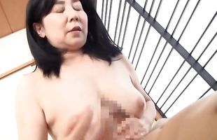Appealing mature sweetheart with round tits eagerly kneels to take hard dinky in her mouth