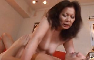Vigorous mature Chizuru Iwasaki bends down for sex