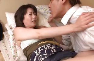Mature Eriko Miura makes a pussy tester wild with desire