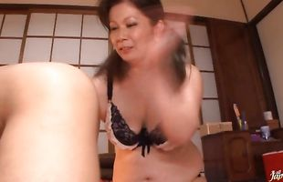 Frisky mature Chizuru Iwasaki swallows giant long sword passionately