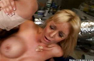 Beguiling mature Holly Sampson enjoys passionate sex