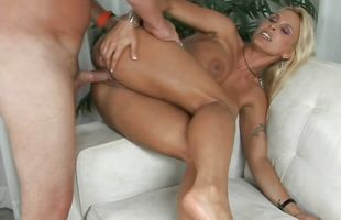 Hot-tempered busty maid Holly Halston is enjoying and moaning from pleasure while stud is fucking her gently