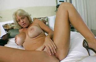 Goluptious busty blonde Charlee Chase gets talked into taking fuckmate's cock from behind
