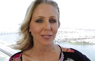 Delightful mature Julia Ann gives an eager blowjob before bending over