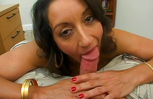 Racy gal Persia keeps an eye contact while slobbering on a dick