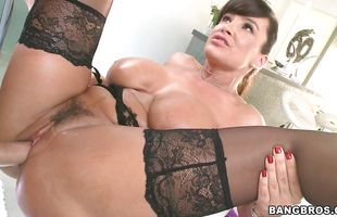 Fascinating mature brunette Lisa Ann plays with her sensitive tits while being roughly pounded