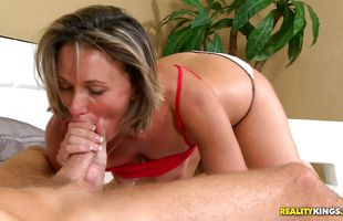 Dissolute mature blonde floozy Misty Law sucks and rides giant white wang passionately