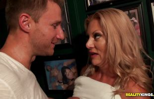 Wanton mature blonde Charity Mclain gets her juicy love tunnel banged hard