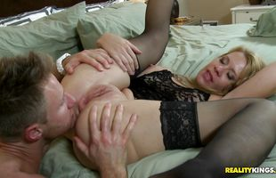 Tempting blonde cougar Desi Dalton with curvy tits is completely naked because she is about to fuck man