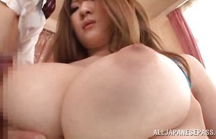 Gorgeous Momoka Nishina with great tits reveals her massive curves before riding a boner