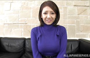 Pungent milf Conomi strokes a penis and plays with her shaved cave