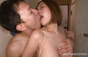 Exquisite mature Ruri Saijo strips while teasing a stiff dick