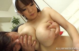Enchanting mature Hitomi teases a slim jim with her round butt cheeks