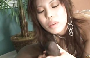 Wonderful busty mature Mei Amazaki with juice poontang reaches a huge top