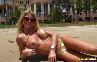 Naked blonde milf Avona Dominica is extremely horny and she receives a big stick