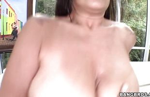 Wicked mature Raylene with massive tits receives a sausage in her pussy