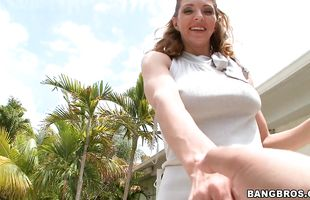 Alluring Roxanne Hall with a huge smile is sucking a hard python